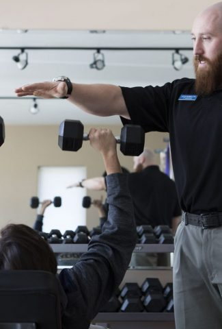 Physical therapist training expert Lucas demonstrates safe lifting to provide recovery from surgery and sports injury rehabilitation in Cody Wyoming