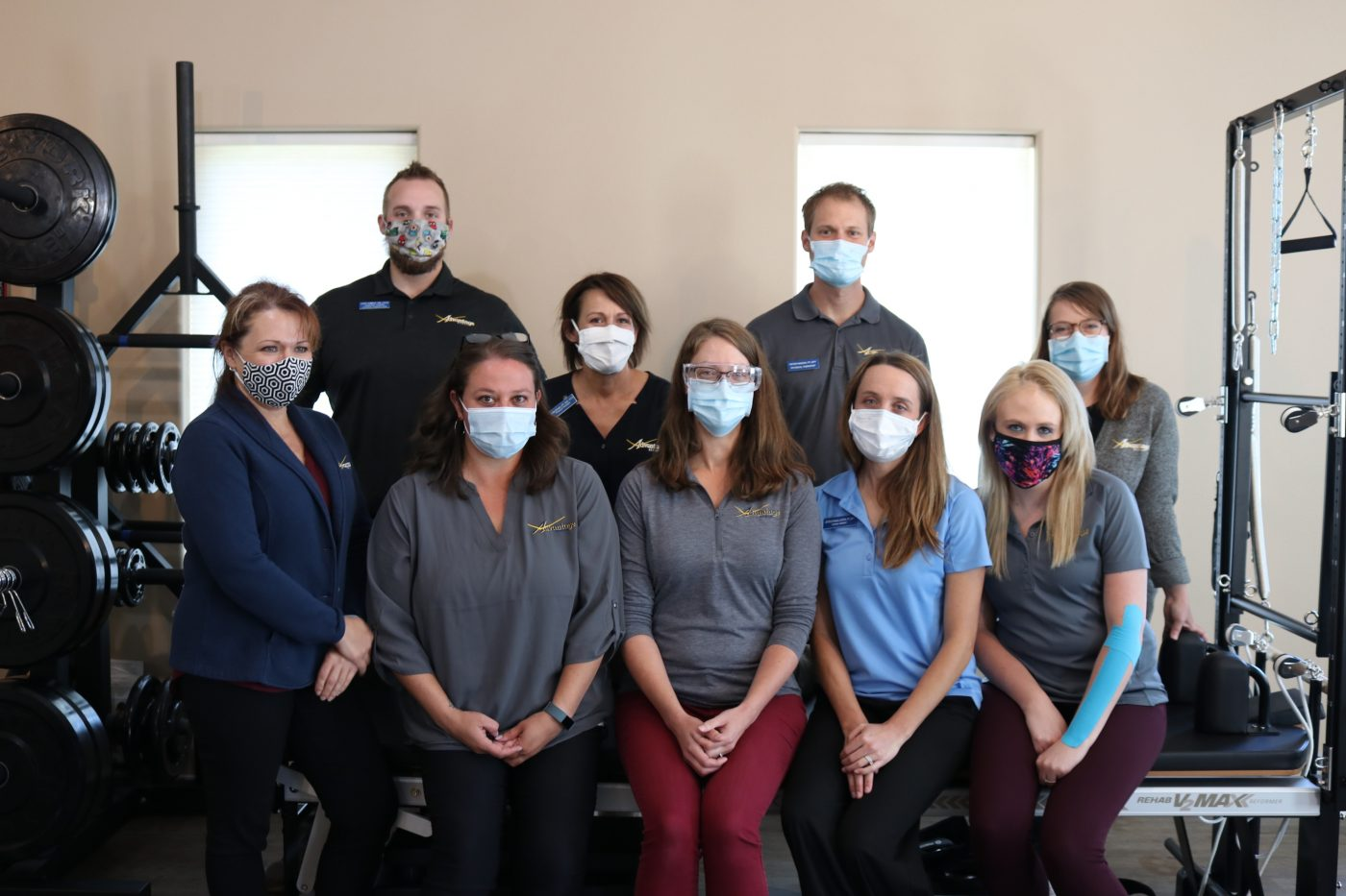 Advantage Rehab staff promoting the use of masks in the office to keep patients and staff members safe and healthy