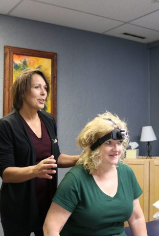 Headache and neck pain management using laser target exercises in Powell Wyoming